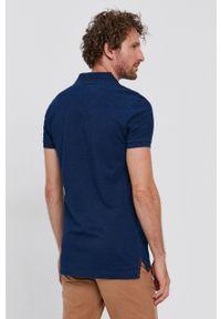 United Colors of Benetton - Polo bawełniane. Okazja: na co dzień. Typ kołnierza: polo. Kolor: niebieski. Materiał: bawełna. Długość: krótkie. Wzór: gładki, aplikacja. Styl: casual