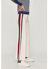 Białe spodnie materiałowe TOMMY HILFIGER z aplikacjami, z podwyższonym stanem