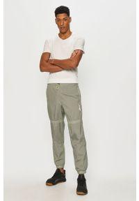 Zielone spodnie dresowe Reebok gładkie