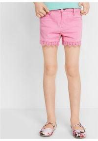 Różowe spodnie bonprix w koronkowe wzory