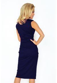 Numoco - Ołówkowa sukienka midi z zaznaczoną talią. Materiał: materiał, elastan. Typ sukienki: ołówkowe. Długość: midi