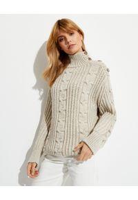 NANUSHKA - Beżowy sweter Devin. Kolor: beżowy. Materiał: jeans, dzianina. Długość rękawa: długi rękaw. Długość: długie. Wzór: ze splotem. Sezon: zima. Styl: klasyczny