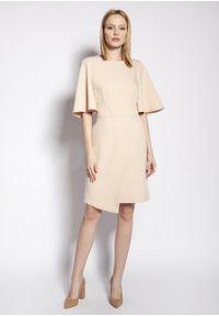 e-margeritka - Sukienka ołówkowa z szerokimi rękawami beżowa - 38. Kolor: beżowy. Materiał: tkanina, materiał, poliester. Typ sukienki: ołówkowe. Styl: elegancki. Długość: midi