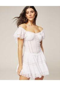 CHARO RUIZ IBIZA - Sukienka mini Lina. Kolor: biały. Materiał: koronka, materiał. Wzór: aplikacja, koronka. Typ sukienki: rozkloszowane. Styl: elegancki. Długość: mini