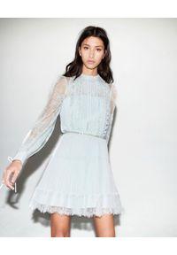 SELF PORTRAIT - Plisowana sukienka mini. Kolor: zielony. Materiał: tkanina, koronka. Długość rękawa: długi rękaw. Wzór: kwiaty, koronka, ażurowy, gładki. Typ sukienki: plisowane, rozkloszowane. Długość: mini