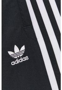 adidas Originals - Spodnie. Kolor: czarny. Materiał: tkanina, poliamid, materiał, poliester. Wzór: gładki