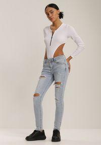 Renee - Jasnoniebieskie Jeansy Skinny Pixeosis. Kolor: niebieski. Długość: długie. Wzór: aplikacja