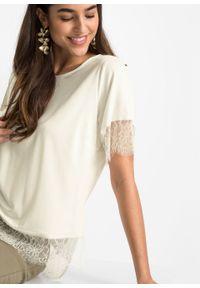 Bluzka zakładana przez głowę, z koronką bonprix kremowy. Kolor: biały. Materiał: koronka. Długość: długie. Wzór: koronka
