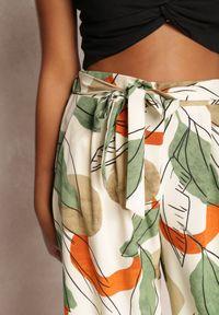 Renee - Kremowe Spodnie Kasdasa. Stan: podwyższony. Kolor: beżowy. Materiał: materiał. Długość: długie. Wzór: gładki, kolorowy