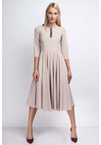 Nommo - Beżowa Rozkloszowana Sukienka za Kolano z Kontrastowym Zamkiem. Kolor: beżowy. Materiał: wiskoza, poliester
