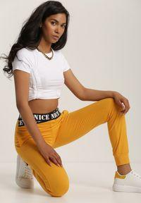 Renee - Żółte Spodnie Dresowe Taphixie. Kolor: żółty. Materiał: dresówka