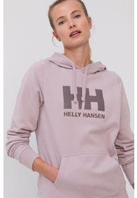 Helly Hansen - Bluza. Typ kołnierza: kaptur. Kolor: różowy. Długość rękawa: długi rękaw. Długość: długie