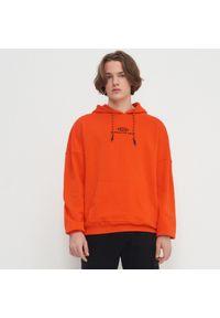 Pomarańczowa bluza House z haftami