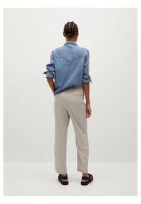 mango - Mango Spodnie materiałowe Fluido 87024755 Beżowy Regular Fit. Kolor: beżowy. Materiał: materiał