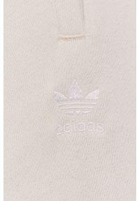 adidas Originals - Spodnie. Kolor: beżowy. Materiał: bawełna