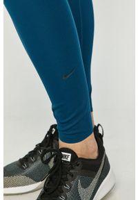 Nike - Legginsy. Kolor: niebieski. Materiał: tkanina, dzianina, poliester, elastan, włókno, skóra. Wzór: gładki #3