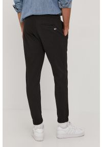 Czarne spodnie dresowe Tommy Jeans melanż