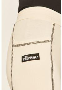 Kremowe legginsy Ellesse z aplikacjami, z podwyższonym stanem
