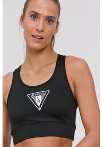 Reebok - Biustonosz sportowy. Kolor: czarny. Materiał: skóra. Wzór: nadruk