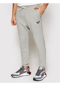 Reebok Spodnie dresowe Identity GJ0633 Szary Regular Fit. Kolor: szary. Materiał: dresówka