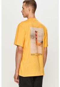 Żółty t-shirt CATerpillar casualowy, z nadrukiem