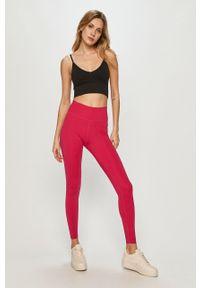 Różowe legginsy Nike gładkie