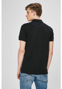 Czarna koszulka polo Ellesse z aplikacjami, na co dzień