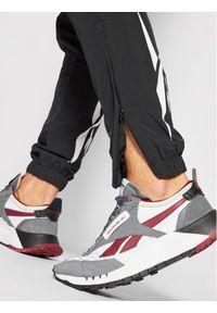 Reebok Classic - Reebok Spodnie dresowe Unisex Classics Vector GJ6015 Czarny Slim Fit. Kolor: czarny. Materiał: dresówka