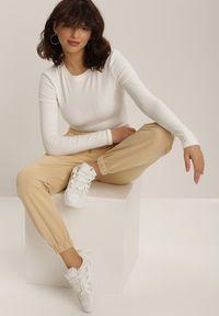 Beżowe spodnie dresowe Renee