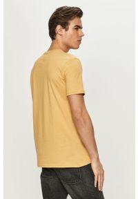 Żółty t-shirt Quiksilver z nadrukiem, casualowy