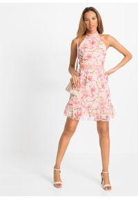 Sukienka z dekoltem halter i falbaną bonprix jasnoróżowy w kwiaty. Typ kołnierza: dekolt halter. Kolor: różowy. Wzór: kwiaty