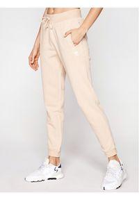 Beżowe spodnie dresowe Adidas