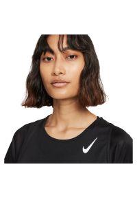 Koszulka damska do biegania Nike Dri-FIT Race DD5927. Materiał: tkanina, skóra, materiał, poliester. Technologia: Dri-Fit (Nike). Długość: długie. Wzór: gładki. Sport: fitness
