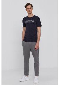 Guess - Spodnie. Kolor: szary. Materiał: bawełna