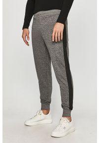 Szare spodnie dresowe Guess Jeans melanż