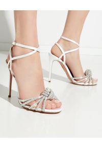 AQUAZZURA - Sandały na szpilce Celeste. Nosek buta: okrągły. Zapięcie: pasek. Kolor: biały. Wzór: aplikacja, paski. Obcas: na szpilce. Styl: klasyczny