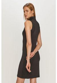 Fila - Sukienka. Kolor: czarny. Materiał: dzianina. Wzór: gładki. Typ sukienki: dopasowane
