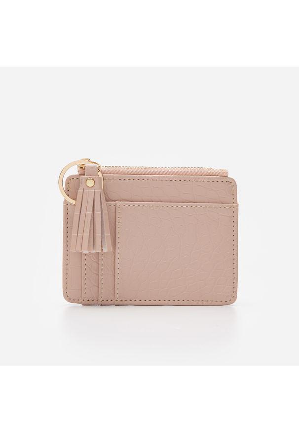 Różowy portfel House