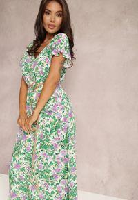 Renee - Zielona Sukienka Kavas. Typ kołnierza: dekolt w serek. Kolor: zielony. Materiał: tkanina. Długość rękawa: krótki rękaw. Wzór: kwiaty, aplikacja. Styl: klasyczny. Długość: maxi