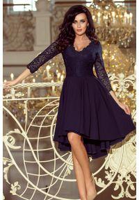 Niebieska sukienka Numoco asymetryczna, wizytowa, w koronkowe wzory