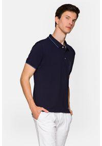 Lancerto - Koszulka Granatowa Polo Dominic. Typ kołnierza: polo. Kolor: niebieski. Materiał: włókno, tkanina, materiał, bawełna. Długość rękawa: krótki rękaw. Wzór: ze splotem. Styl: klasyczny