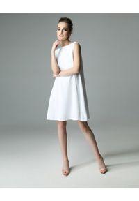 Biała sukienka Madnezz z aplikacjami