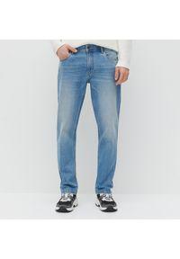 Niebieskie jeansy Reserved