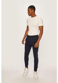 Lacoste - Spodnie XH9507. Kolor: niebieski. Materiał: materiał, bawełna, dzianina, poliester, elastan. Wzór: gładki #2