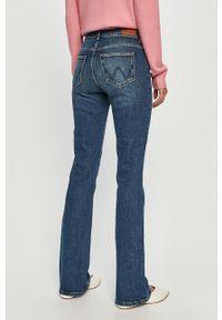 Niebieskie jeansy bootcut Wrangler