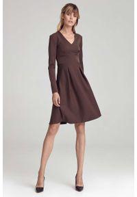Nife - Trapezowa Sukienka z Długim Rękawem - Brązowa. Kolor: brązowy. Materiał: poliester, wiskoza, elastan. Długość rękawa: długi rękaw. Typ sukienki: trapezowe
