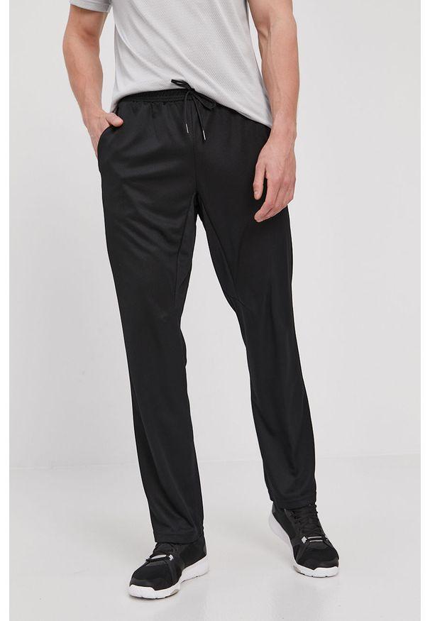 Reebok - Spodnie. Kolor: czarny. Materiał: materiał, tkanina, poliester. Wzór: gładki