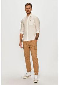 Beżowe spodnie Tommy Jeans na co dzień, casualowe