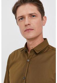Hugo - Koszula bawełniana. Typ kołnierza: kołnierzyk klasyczny. Kolor: zielony. Materiał: bawełna. Długość rękawa: długi rękaw. Długość: długie. Styl: klasyczny
