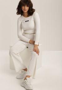 Renee - Białe Spodnie Szerokie Salanome. Kolor: biały